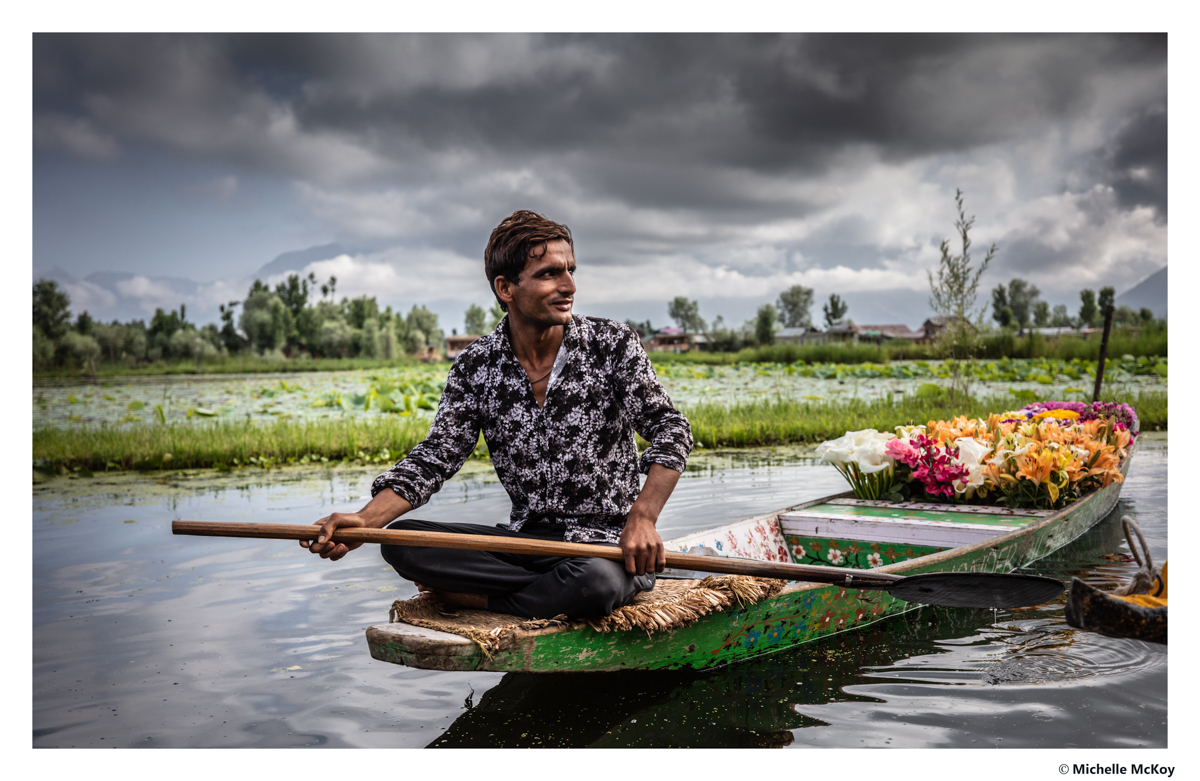 A photo of a man in his boat selling flowers on the lake Dal Lake Kashmir