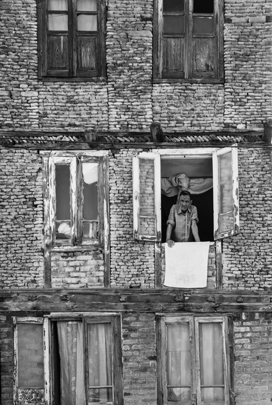 Street photography of a local man in his house in Srinigar, Kashmir